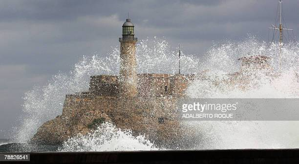 The Morro Castle is seen through a wave that breaks against the Malecon waterfront in Havana 02 January 2008 An abrupt change of weather is affecting...