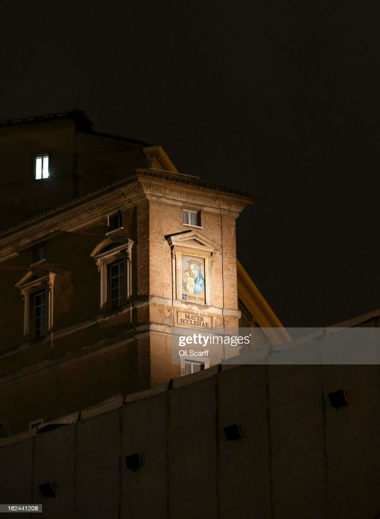 The mosaic mural 'Mater Ecclesiae' is illuminated in Saint Peter's Square on February 23, 2013 in Vatican City, Vatican. Pope Benedict XVI is due to hold his last weekly public audience tomorrow before he retires on Thursday. Pope Benedict XVI has been the leader of the Catholic Church for eight years and is the first Pope to retire since 1415. He cites his retirement due to ailing health and is to spend the rest of his life in solitude away from any public engagements.
