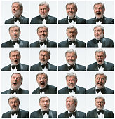 The mosaic of senior businessman expressing different emotions. The bearded businessman with suit with 20 different emotions isolated on white. The studio shot.