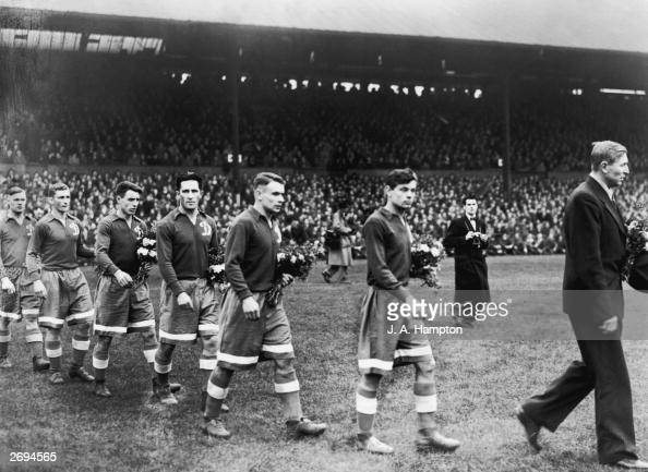 The Moscow Dynamo team walk on to the pitch at Stamford Bridge with bouquets of flowers to present to the Chelsea team before the match The game...