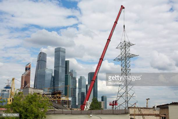 The Moscow International Business Center also known as 'Moscow City' stands on the skyline beyond a construction site in the Presnensky district of...