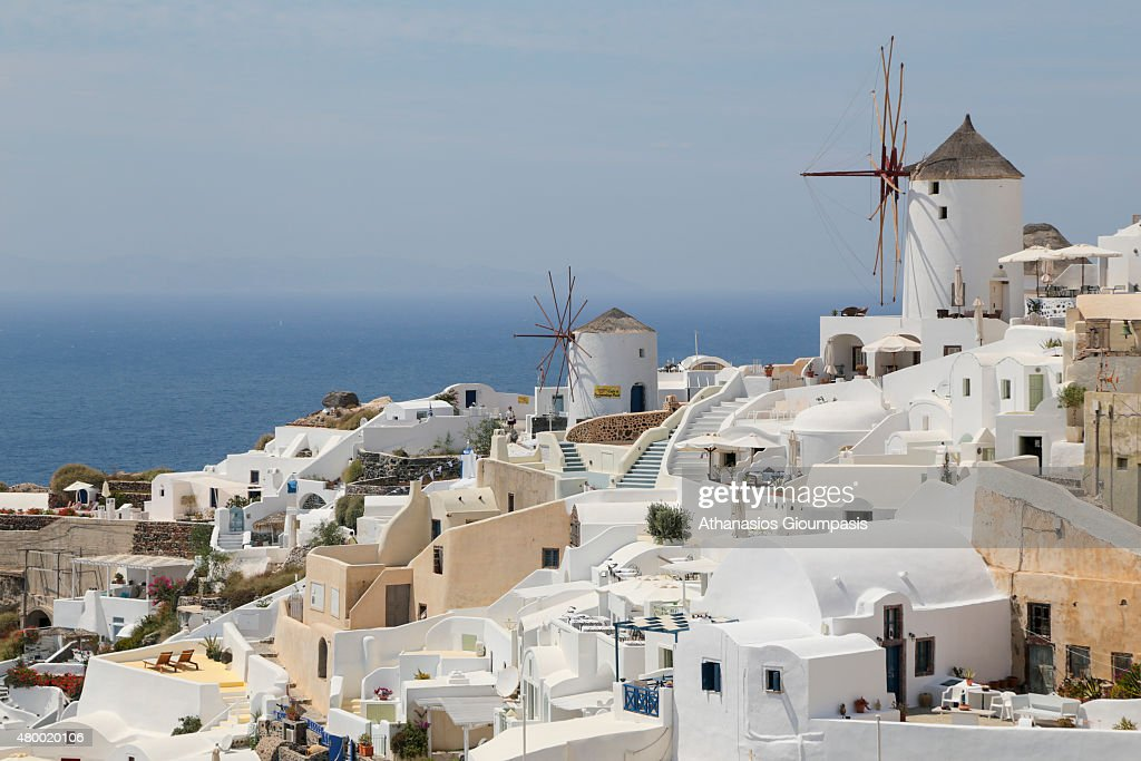 The most recognisable buildings in the town an old windmill at Oia town on June 30 2015 in Santorini GreeceOia typifies the white painted houses of...