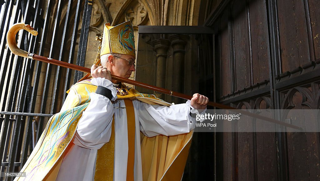 The Most Reverend Justin Welby, strikes three times on the West Door of Canterbury Cathedral with his pastoral staff prior to his enthronement service to become Archbishop of Canterbury at Canterbury Cathedral on March 21, 2013 in Canterbury, England. The newly appointed Archbishop of Canterbury Justin Welby is enthroned today, installing him as the 105th Archbishop of Canterbury and head of the Church of England, in front of bishops and religious of the Anglican communion from around the world, the Prime Minister David Cameron, The Prince of Wales and other dignitaries.