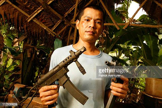 The most wanted automatic assault weapons in the Philippes are Ingrams and Uzis despite being illegal Pictured here is one of the top specialist...