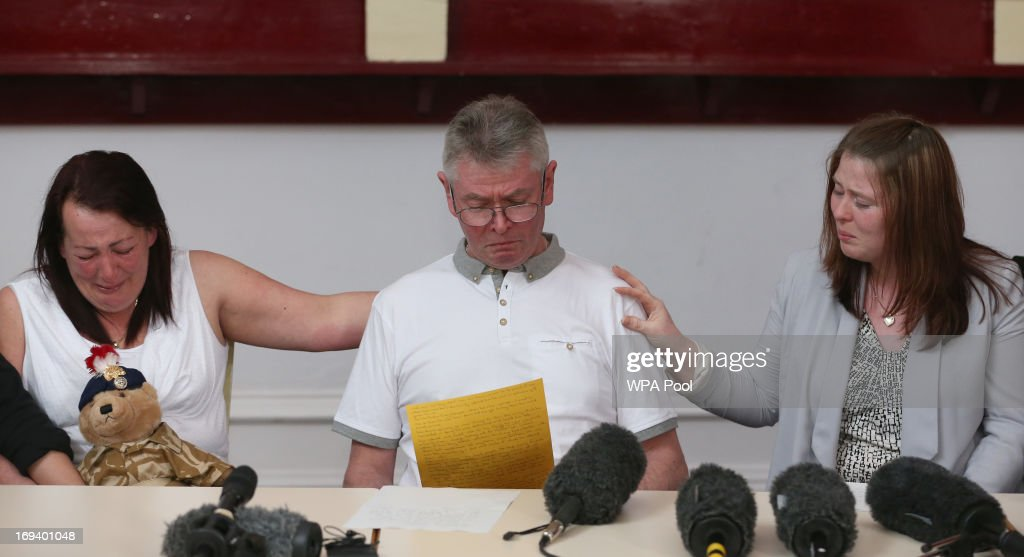 The mother and stepfather of murdered soldier Lee Rigby Lyn and Ian Rigby and his wife Rebecca Rigby grieve as his stepfather reads a family...