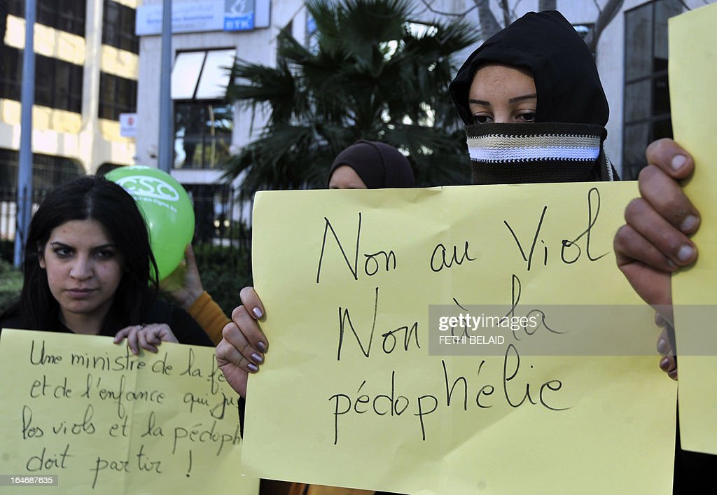 The mother (R) of a three-year-old girl who was allegedly raped by the janitor at her kindergarten, and who has, along with others, demanded the resignation of Tunisia's minister for women's affairs, takes part in a mass protest in the center of Tunis following the opening of the World Social Forum (WSF) on March 26, 2013. More than two years after the Jasmine revolution, tens of thousands of people are expected for the WSF, dubbed the forum of 'dignity', a watchword of the Tunisian uprising that inspired revolts across the Arab world.