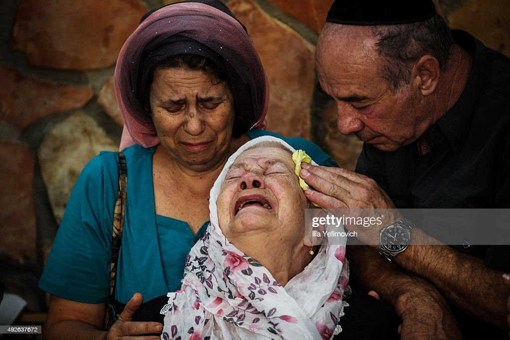 The mother of Albert Alon Govberg mourns at his funeral on October 14 2015 in Jerusalem Israel Alon was killed the day before in an attack on a...