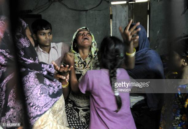 TOPSHOT The mother of an Indian girl who was raped and set on fire cries out during her daughter's funeral in Greater Noida near the Indian capital...