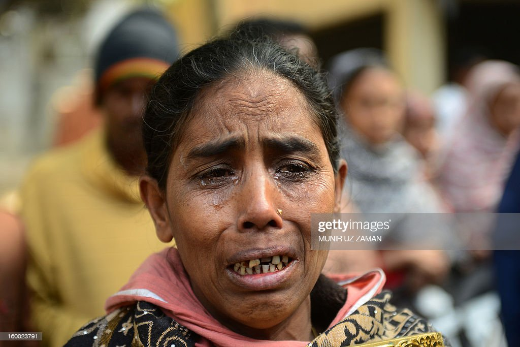 The mother of factory fire victim, Fathema Ahenur weeps during a protest demanding punishment for the Tazreen Fashion factory owner and compensation for the victims of the 2012 factory fire, in Savar, some 30 kilometres north of Dhaka on January 25, 2013. At least 124 people were killed in a massive blaze which engulfed the multi-storey garment factory on the outskirts of the Bangladesh capital in one of the worst fire tragedies in the country on November 25, 2012. AFP PHOTO/Munir uz ZAMAN