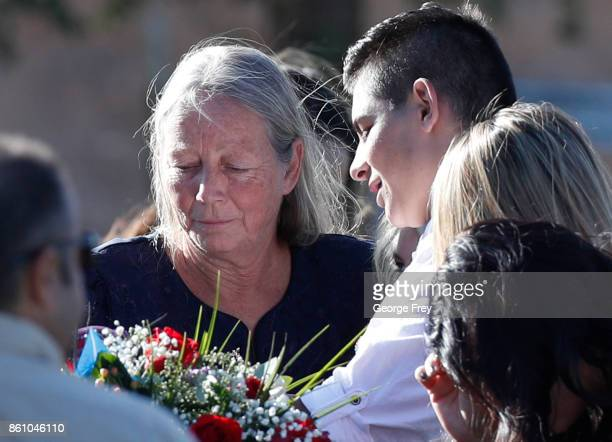 The mother of Heather Lorraine Alvarado pays her final respects at her daughters casket on October 13 2017 in Enoch Utah Alvarado was a 35 year old...