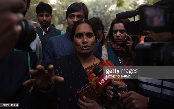The mother of Indian gangrape victim 'Nirbhaya' talks to the media as she attends a rally held to protest the release of a juvenile rapist in New...