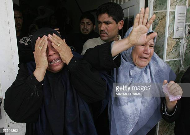 The mother of Jumaa Doughmoush mourns with unidentified relatives during his funeral in Gaza City 06 May 2006 Dogmosh is one of five Palestinians who...