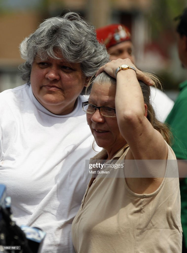 The mother of kidnap victim Gina DeJesus, Nancy Ruiz, talks with her sister Sandra Ruiz during a press conference on May 8, 2013 in Cleveland, Ohio. Amanda Berry, Gina DeJesus, and Michelle Knight managed to escape their captors on May 6, 2013. Ariel Castro was charged with kidnap and rape. His brother Pedro and Onil Castro, were taken into custody but not charged.