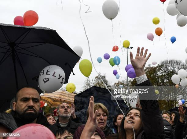 The mother of missing French girl Maelys de Araujo Jennifer is joined by others as they release balloons while gathering in Les AbretsenDauphiné...