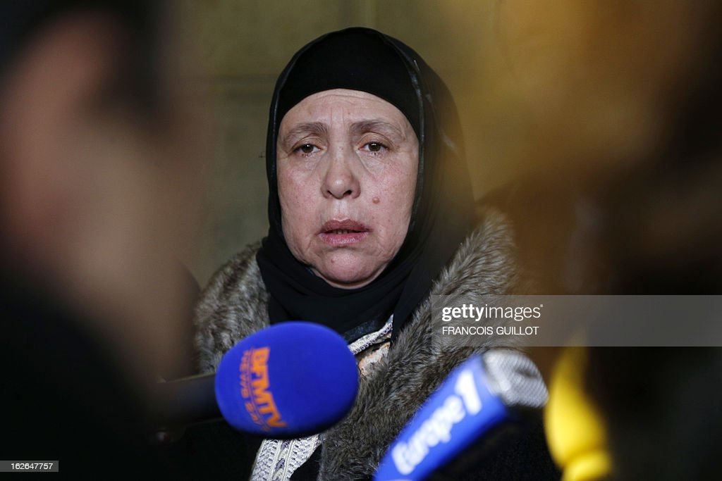 The mother of Mohammed Legouad, one of the victims of Islamist gunman Mohamed Merah in March 2012, speaks to the media upon her arrival at Paris courthouse on February 25, 2013 before meeting the investigating anti-terror judges.
