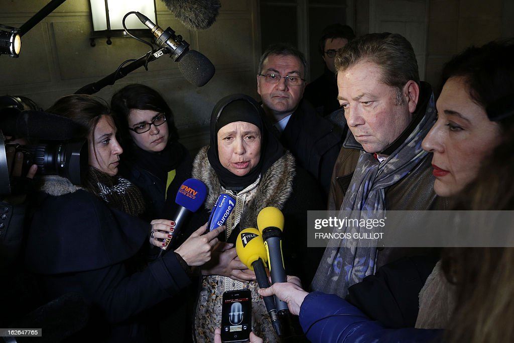 The mother (C) of Mohammed Legouad, one of the victims of Islamist gunman Mohamed Merah in March 2012, speaks to the media beside her lawyer Olivier Morice (2ndR) upon her arrival at Paris courthouse on February 25, 2013 before meeting the investigating anti-terror judges.