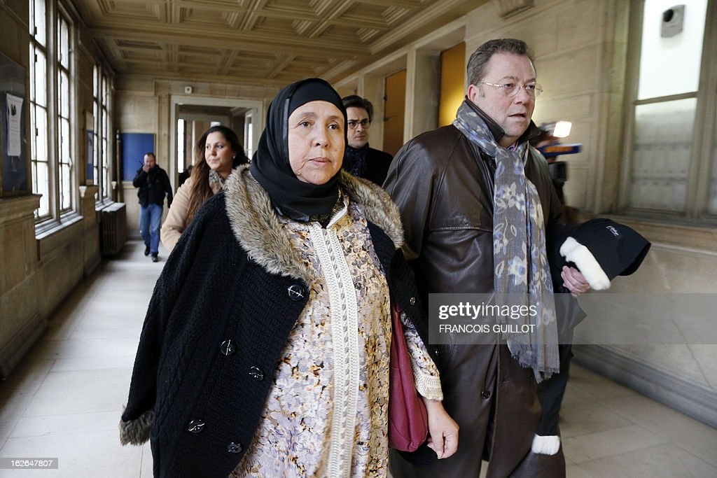 The mother (L) of Mohammed Legouad, one of the victims of Islamist gunman Mohamed Merah in March 2012, arrives with her lawyer Olivier Morice (R) at Paris courthouse on February 25, 2013 before meeting the investigating anti-terror judges.