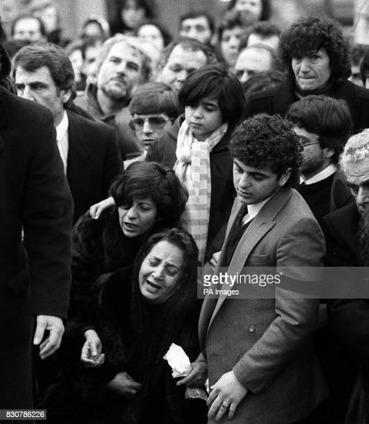 The mother of murdered fashion millionaire Aristos Constantinou grieves at her son's graveside at Edmonton Cemetery in north London after the funeral...