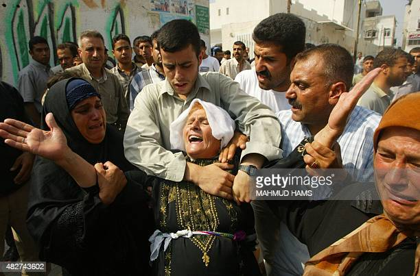 The mother of Nahed Abu Awda aged around 40 and a member of Hamas' Ezzedine alQassam Brigades military branch weep upon hearing that her son was in...