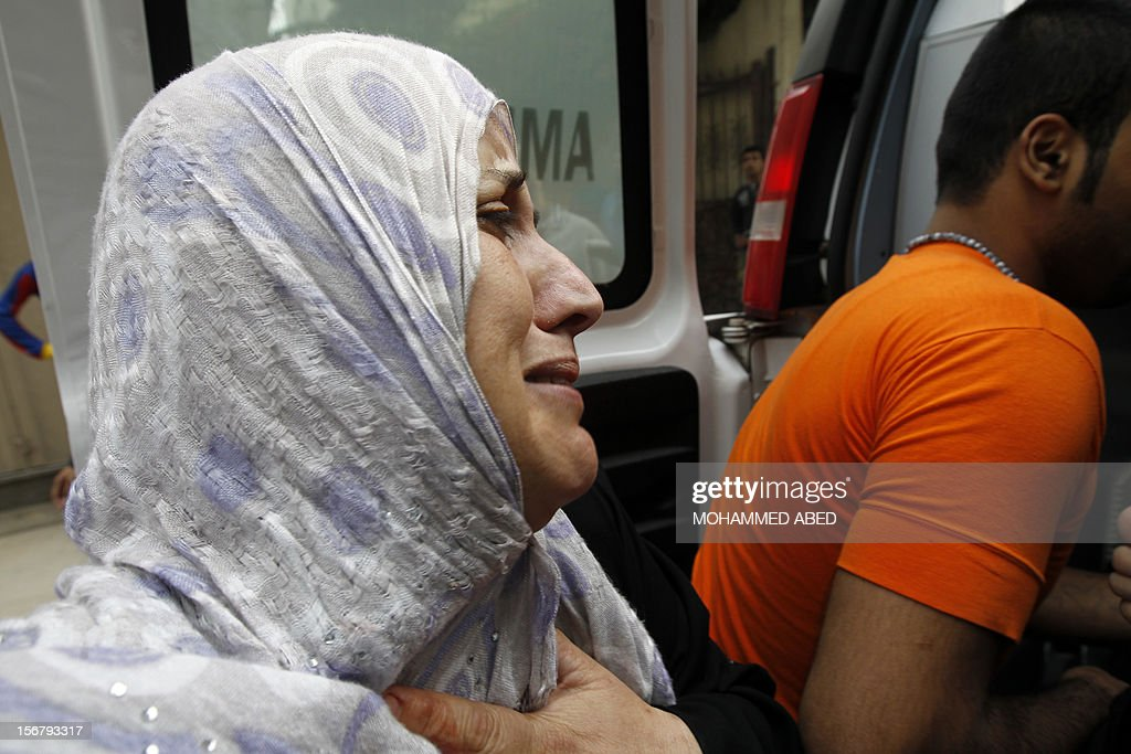 The mother of Palestinian boy Abdel Rahman Majdi Naim cries after her son was killed in a second Israeli strike on the building housing AFP's offices in Gaza city, according to Hamas health officials, on November 21, 2012. The Israeli military had no immediate comment on the strike, which came less than 24 hours after Israeli warplanes carried out a first raid on the building. AFP PHOTO/MOHAMMED ABED