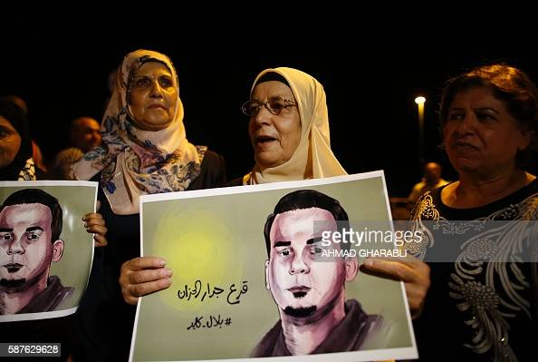 The mother of Palestinian prisoner Bilal Kayed who has been fasting for 53 days over his detention without trial demonstrates against administrative...