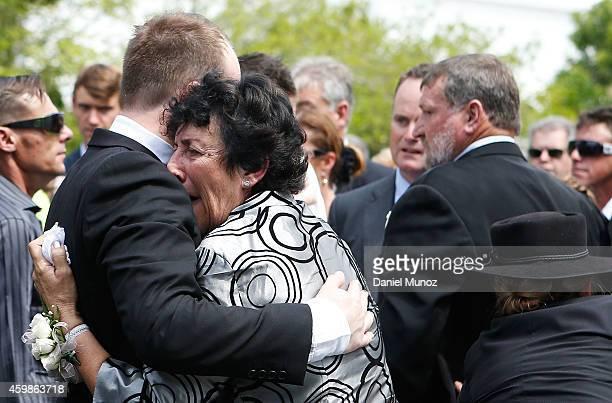 The Mother of Phillip Hughes Virginia embraces her son Jason during Phillip Hughes funeral on December 3 2014 in Macksville Australia Australian...