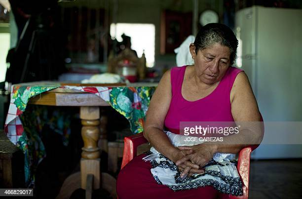 The mother of Salvadorean castaway Jose Salvador Alvarenga Maria Julia Alvarenga waits for a TV interview at her house in Garita Palmera 102 km west...