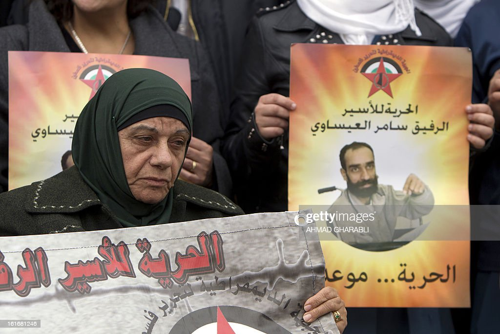 The Mother of Samer Issawi, a Palestinian prisoner who has been on hunger strike for more than 200 days, attends a solidarity sit-in outside the Red Cross offices in Jerusalem, on February 14, 2013. A United Nations official expressed concern about the well being of Palestinian detainees in Israeli prisons and in particular about the condition of hunger striker Issawi. AFP PHOTO/AHMAD GHARABLI