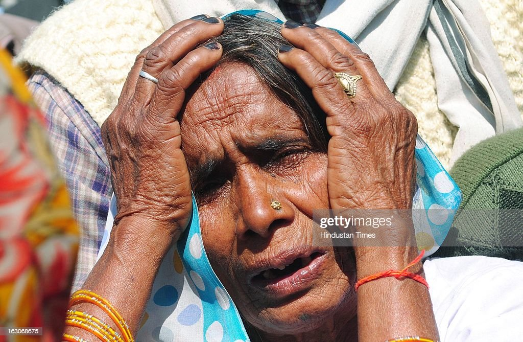 The mother of slain Balipur gram Pradhan Nanhey Yadav grieving on March 3, 2013 in the Kunda area of Pratapgarh, India. A close confidant of Kunda MLA and state minister Raghuraj Pratap Singh alias Raja Bhaiyya, Nanhe Yadav was murdered by two unidentified gunmen in Village market. The case took another turn after the circle officer of Kunda Zia-ul-Haq who rushed to the site along with other police officials was killed in gunshot from unidentified man in crowd.