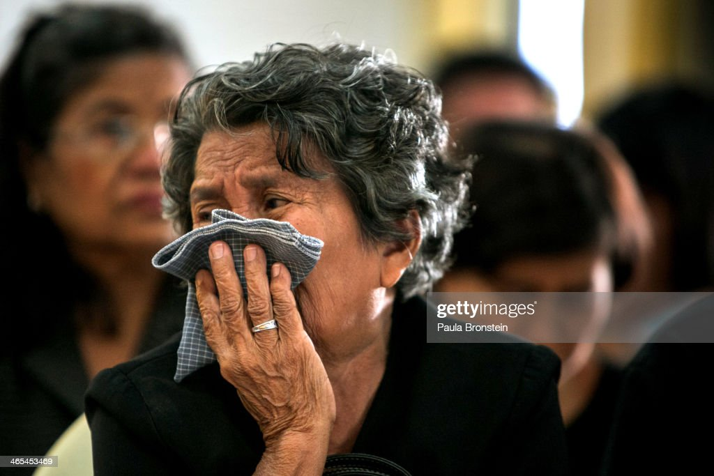 The mother of Sutin Tharatin grieves at his funeral in Bangkok on January 27, 2014 in Bangkok, Thailand. Nine others were also injured during election related violence as protesters blocked polling stations as advanced voting took place in the capital city. Bangkok Shutdown has been in effect for two weeks as the anti-government protesters continue to block major intersections. The Thai government imposed a 60-day state of emergency in Bangkok and the surrounding provinces in an attempt to cope with the on-going political turmoil but so far this decree has had no effect on the mass protests.