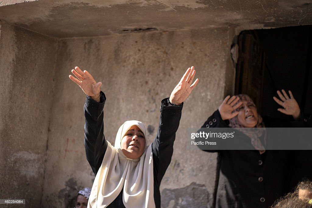 The mother of the four Palestinian children killed by an Israeli airstrike whilst playing on the shore of the Gaza strip, mourns.