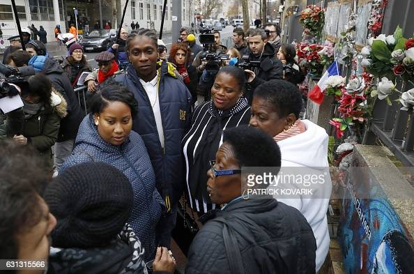 The mother of the late policewoman Clarissa JeanPhilippe surrounded by her family stand near a memorial during a tribute ceremony two years after the...