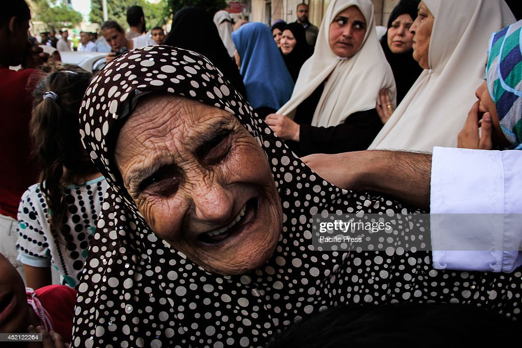 The mother of the martyr Nidal Al-malash during the funeral of her son, who was killed during the raid of the Israeli Air Force in central Gaza City in the sixth day of the Israeli offensive on Gaza, according to the Palestinian Ministry of Health 128 died, about 1,200 wounded, and demolition of more than 500 houses.