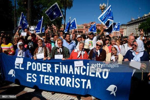 The Mothers of Plaza de Mayo are joined on October 19 2017 in their weekly march in front of the presidential palace in Buenos Aires by people called...