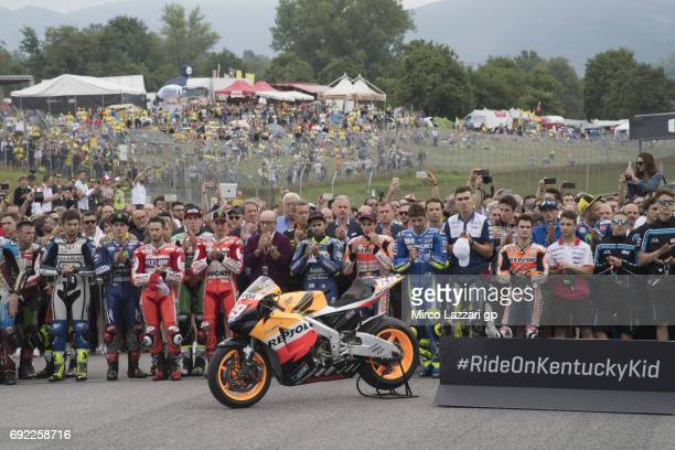 The MotoGP family on track during the '69 Seconds Of Silence for Nicky Hayden the Kentucky Kid' during the MotoGP race during the MotoGp of Italy...