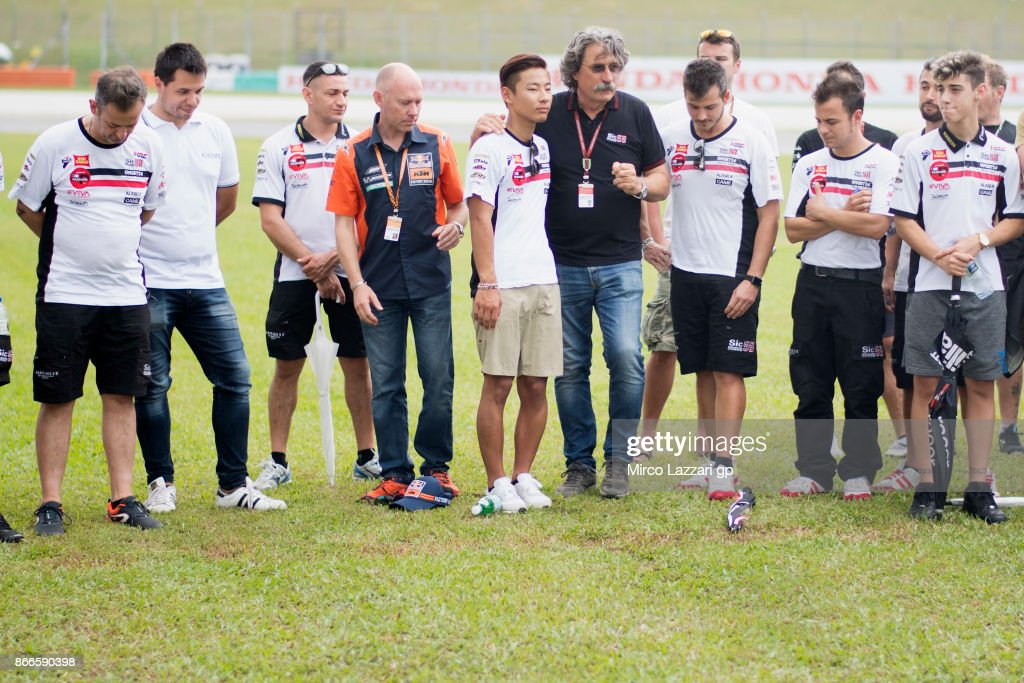 The MotoGp family pay a tribute to Marco Simoncelli's memory (in center Paolo Simoncelli father of Marco Simoncelli of Italy) during the 'Track walk to Turn 11 for SIC ' ahead of the MotoGP of Malaysia at Sepang Circuit on October 26, 2017 in Kuala Lumpur, Malaysia.