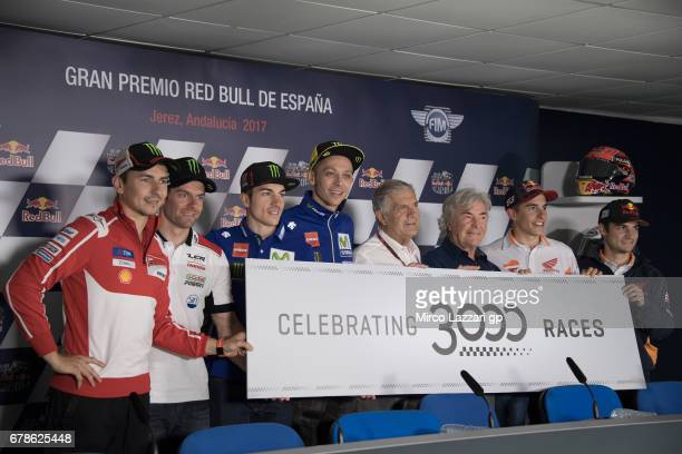 The MotoGP riders Giacomo Agostini of Italy and Angel Nieto of Spain pose and celebrate the 3000 races during the press conference during the MotoGp...
