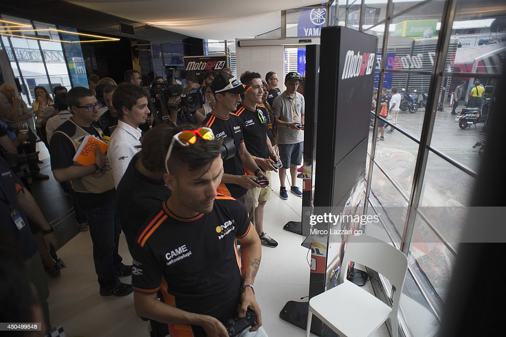 The MotoGP riders play during the event 'Milestone presents the official MotoGP 2014 videogame' during the MotoGp of Catalunya- Previews at Circuit de Catalunya on June 12, 2014 in Montmelo, Spain.