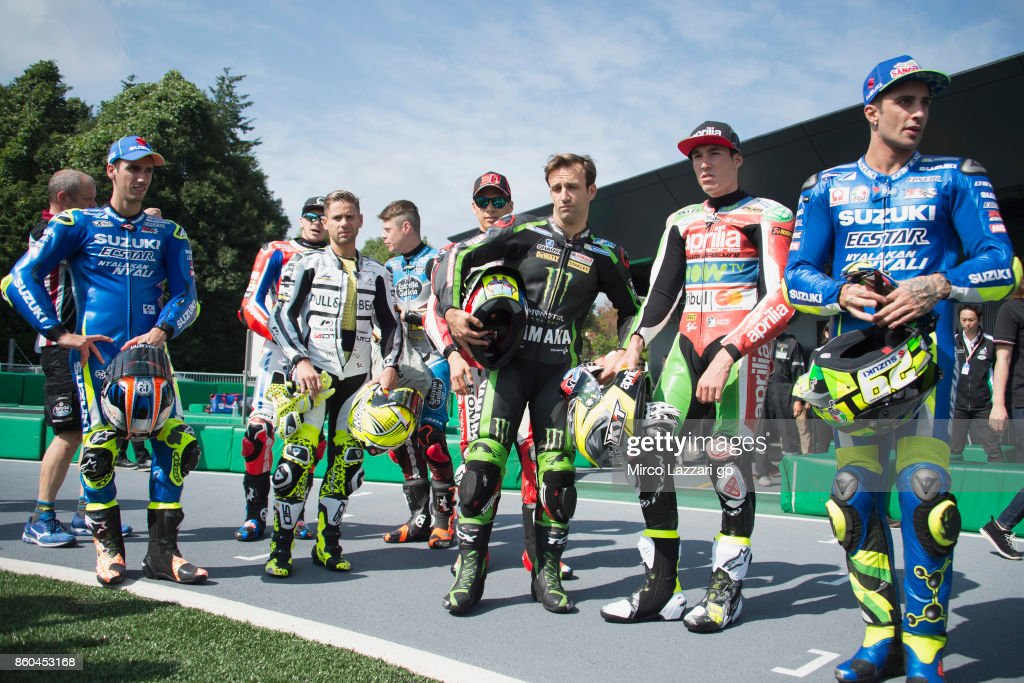 The MotoGP riders pose during the pre-event 'The mini-battle between the MotoGP riders and children with electric mini bikes at Mobi Park at Motegi' ahead of the MotoGP of Japan at Twin Ring Motegi on October 12, 2017 in Motegi, Japan.