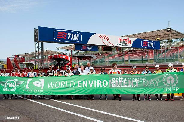 The MotoGP riders pose for 'World Environment Day' before the second free practice of the Grand Prix of Italy on June 5 2010 in Mugello Circuit near...
