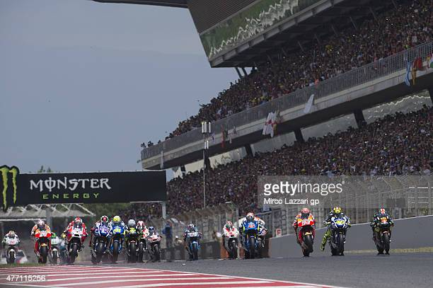 The MotoGP riders start from the grid during the MotoGP race during the MotoGp of Catalunya at Circuit de Catalunya on June 14 2015 in Montmelo Spain