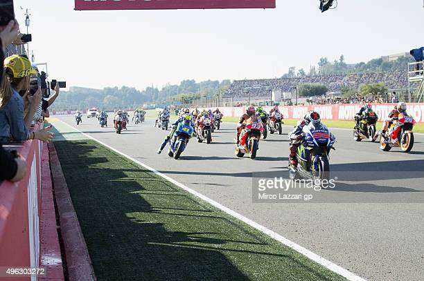 The MotoGP riders start from the grid during the MotoGP race during the MotoGP of Valencia Race at Ricardo Tormo Circuit on November 8 2015 in...