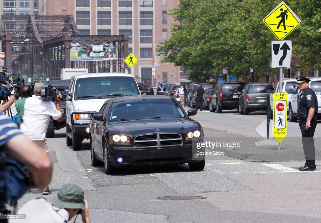 The motorcade carrying alleged Boston Marathon bomber Dzhokhar Tsarnaev arrives at the John Joseph Moakley Courthouse in Boston, July 10, 2013.