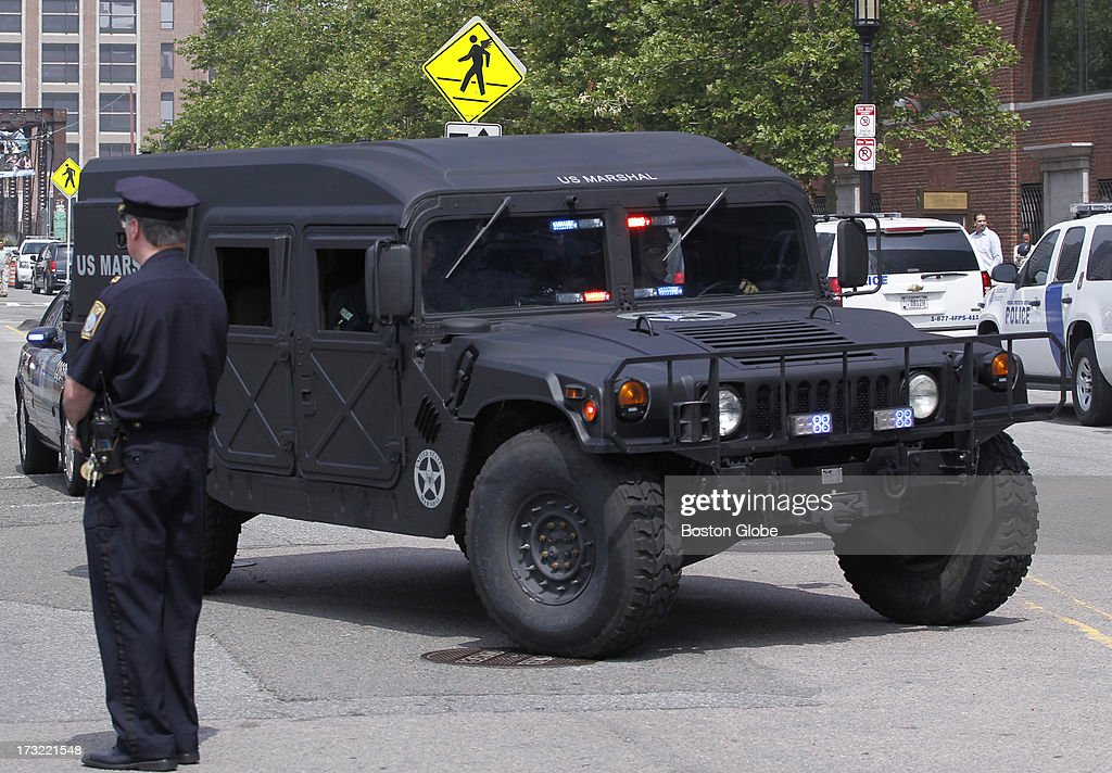 The motorcade carrying alleged Boston Marathon bomber Dzhokhar Tsarnaev arrives at the John Joseph Moakley Courthouse in Boston, July 10, 2013.