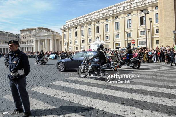 The motorcade carrying Queen Elizabeth II arrives at Saint Peter's Square on April 3 2014 in Rome Italy During their brief visit The Queen and the...