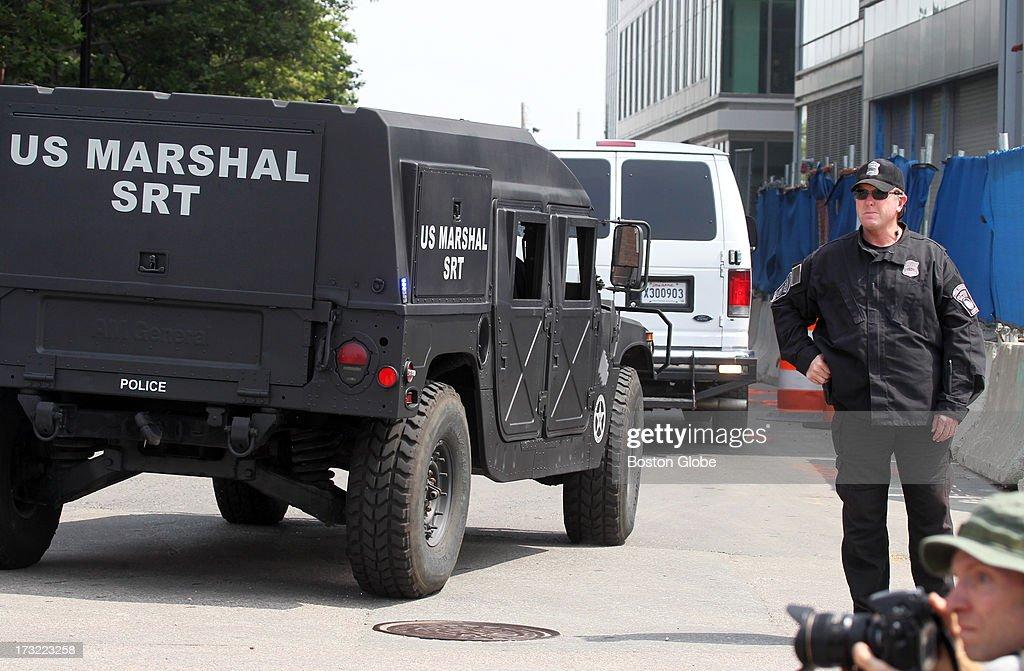 The motorcade containing alleged Boston Marathon bomber Dzhokhar Tsarnaev arrives at the John Joseph Moakley Courthouse in Boston, July 10, 2013.
