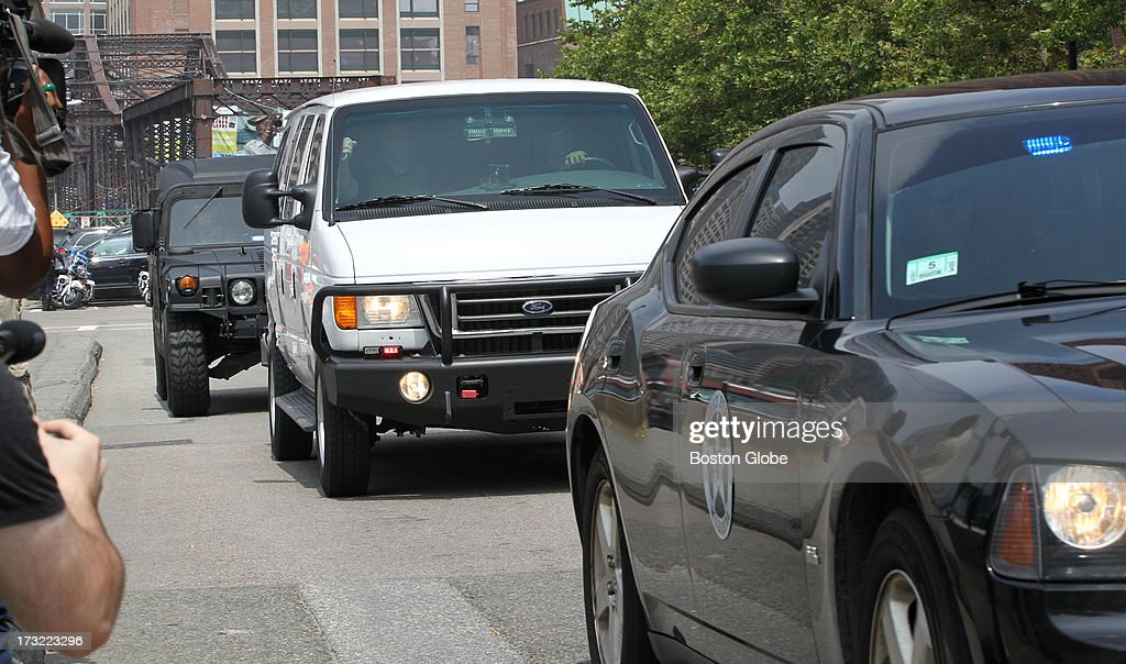The motorcade containing alleged Boston Marathon bomber Dzhokhar Tasarnaev arrives at the John Joseph Moakley Courthouse in Boston, July 10, 2013.