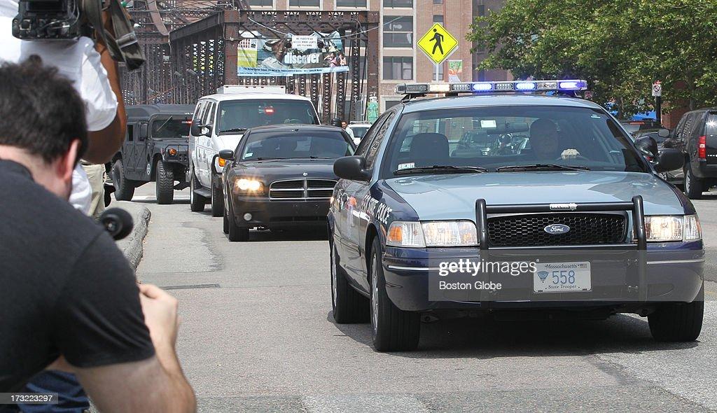 The motorcade containing alleged Boston Marathon bomber Dzhokhar Tasarnaev arrives at the John Joseph Moakley Courthouse in Boston, July 10, 2013.