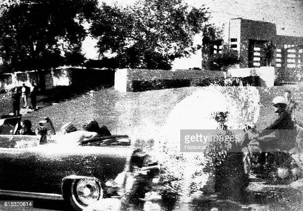 The motorcade drives on after John F Kennedy is shot November 22 Dallas Texas