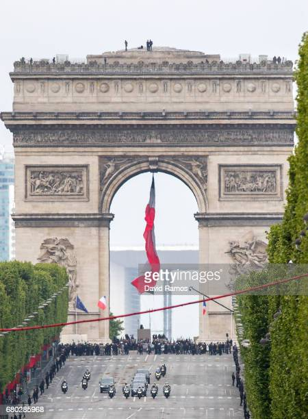 The motorcade of French presidentelect Emmanuel Macron and outoing president Francois Hollande drives down the Champs Elysse after attending the...